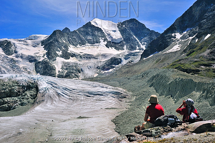 Hikers resting with view over the Moiry Glacier, Pennine Alps, Valais, Switzerland, July 2009  -  Philippe Clement/ npl