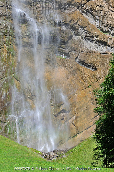 Tourists at a view point in the rockface enjoying the 300m high Staubbach Falls, Lauterbrunnen, Bernese Oberland, Switzerland, July 2009  -  Philippe Clement/ npl