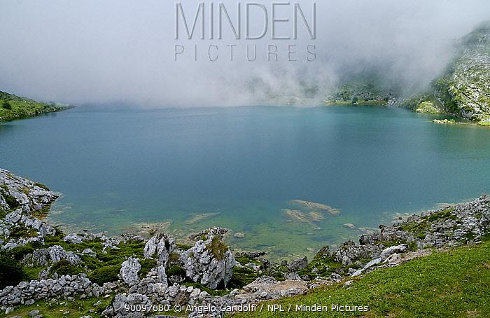 Fog rolling over Covadonga Lakes, Picos de Europa National Park, Asturias, Spain July 2008  -  Angelo Gandolfi/ npl