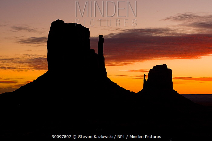 West and East Mitten buttes silhouetted at sunset, Monument Valley, Navajo Tribal Park, Arizona, USA February 2009  -  Steven Kazlowski/ npl