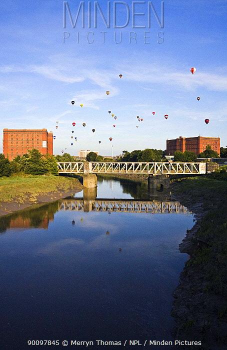 Bristol Balloon Fiesta over bridge and warehouses on the Avon River, Bristol, UK, August 2009  -  Merryn Thomas/ npl