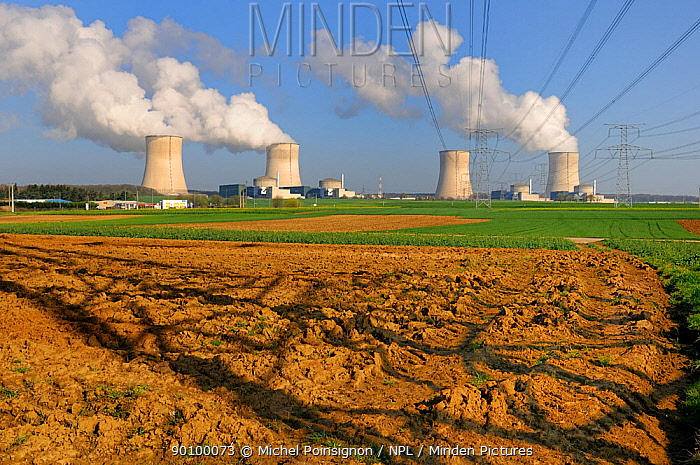 Cooling towers of Nuclear power station with farmland in the foreground, Cattenom, France  -  Michel Poinsignon/ npl