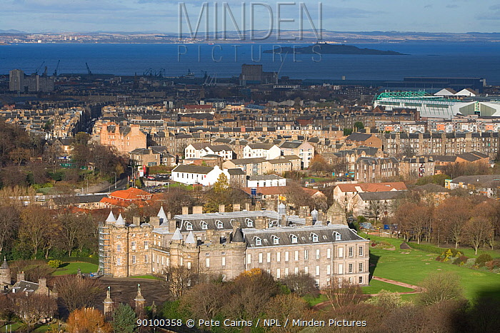 View over Holyrood Palace and Edinburgh city centre from Salisbury Crags, with Firth of Forth in the background, Edinburgh, Scotland, UK, November 2008  -  Pete Cairns/ npl