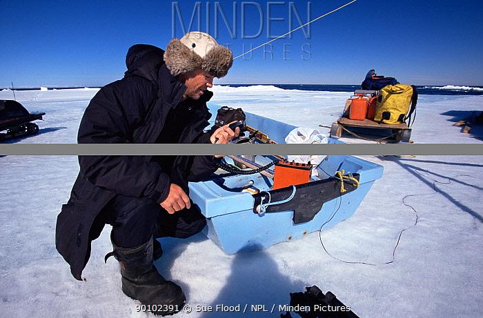 Cameraman Doug Allan on radio to Polar Shelf during rescue from ice floe, Canadian Arctic, June 2000  -  Sue Flood/ npl