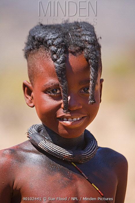 Himba girl with two distinctive plaits, Kaokoland, Namibia, August 2007  -  Sue Flood/ npl