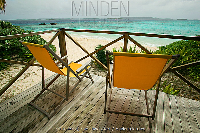 Two empty deckchairs on platform looking out to sea, Vavau islands, Kingdom of Tonga, South Pacific, September 2007  -  Sue Flood/ npl