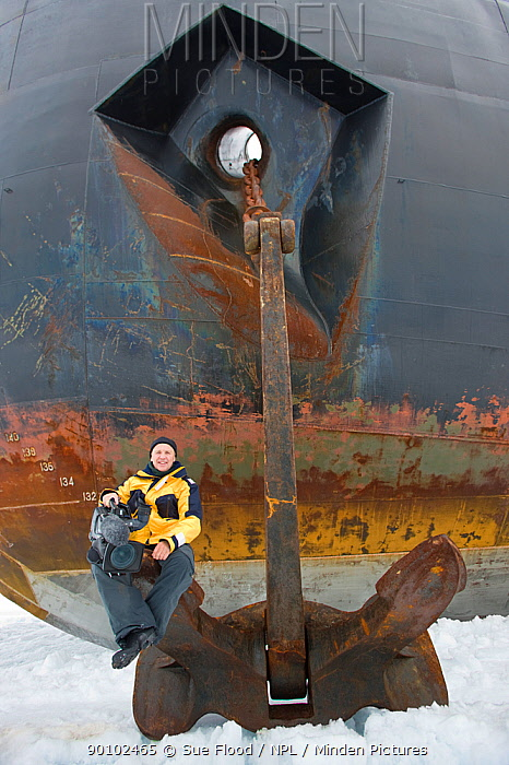 Cameraman Doug Allan, sitting on anchor of Russian nuclear icebreaker, NS 50 Lyet Pobyedi (50 years of Victory) en route to the North Pole, July 2008  -  Sue Flood/ npl