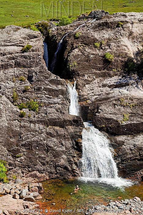 Man swimming in mountain pool at foot of waterfall, Glen Coe, Scotland, June 2009  -  David Kjaer/ npl