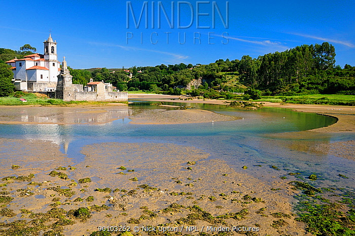 Niembro Bay with church and cemetery of Los Dolores at low tide, near Llanes, Asturias, Spain July 2009  -  Nick Upton/ npl