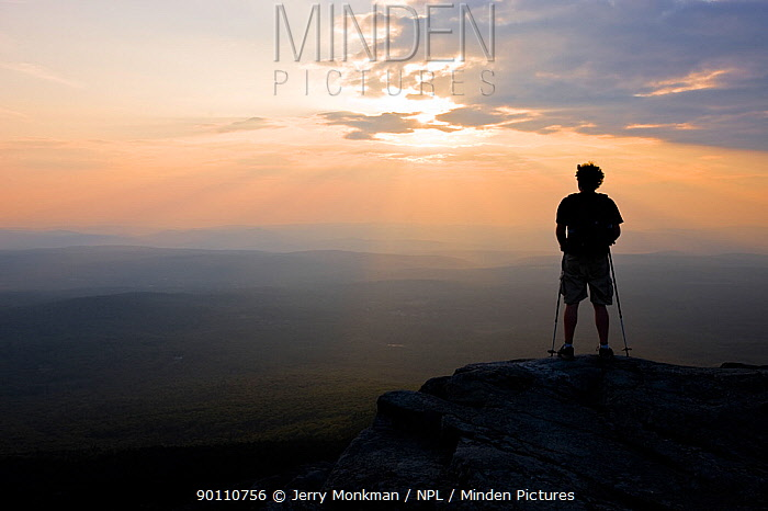 Man watching sunset on the summit of Mount Monadnock in Monadnock State Park, New Hampshire, USA, September 2008  -  Jerry Monkman/ npl