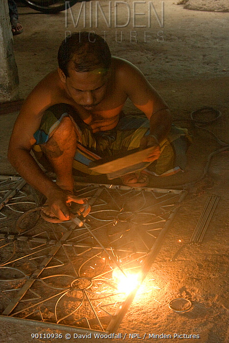 Man learning welding on a rural training scheme organised by an NGO, Uttaran, Ganges delta, Bangladesh, November 2008  -  David Woodfall/ npl