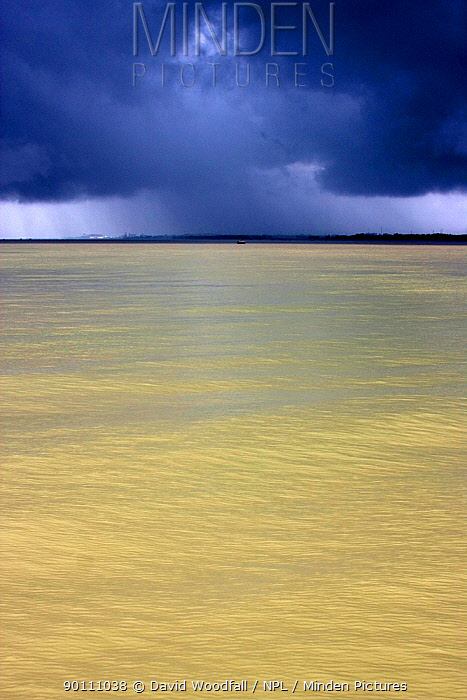 Dark monsoon rain clouds over the Pasur river, Ganges delta, Bangladesh, November 2008  -  David Woodfall/ npl