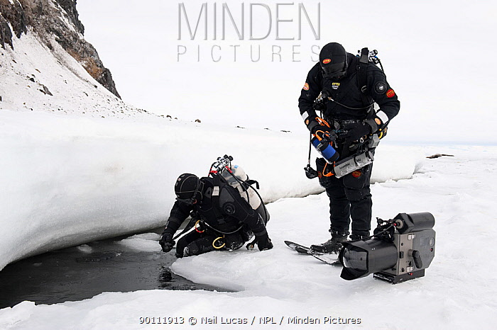Doug Allan, BBC cameraman and another, preparing to enter ice-hole for underwater filming, McMurdo Sound, Ross Sea, Antarctica, November 2008  -  Neil Lucas/ npl