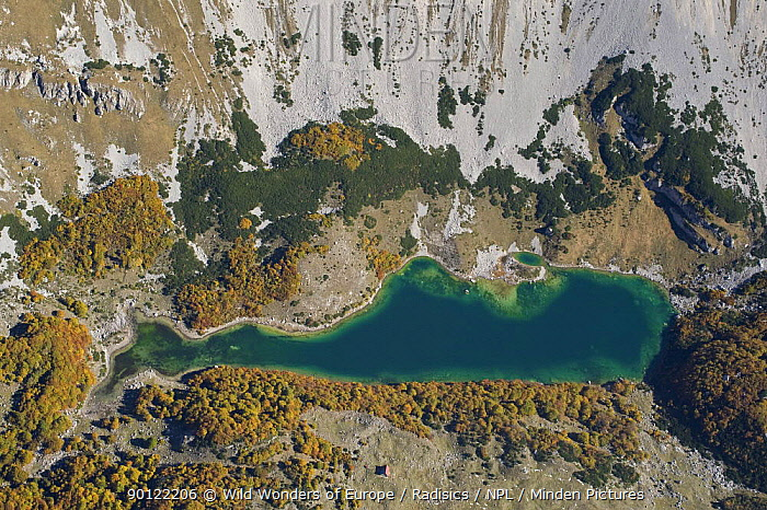 Aerial view of Skrcko Lake with a Katun (shepherd's summer hut) Durmitor NP, Montenegro, October 2008  -  WWE/ Radisics/ npl