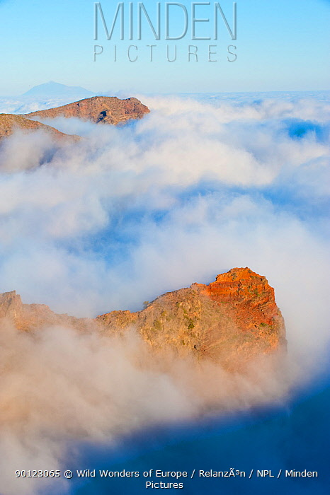 Mountains surrounded by clouds, with an island in the distance, La Caldera de Taburiente National Park, La Palma, Canary Islands Spain, March 2009  -  WWE/ Relanzon/ npl