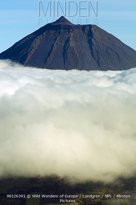 Clouds around Pico, the highest mountain in Portugal, sticking out through a loayer of clouds, Azores, Portugal, June 2009  -  WWE/ Lundgren/ npl