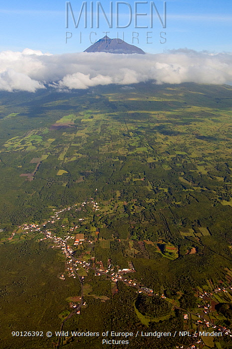 Aerial view of village and countryside with Mt Pico and clouds in the distance, Azores, June 2009  -  WWE/ Lundgren/ npl