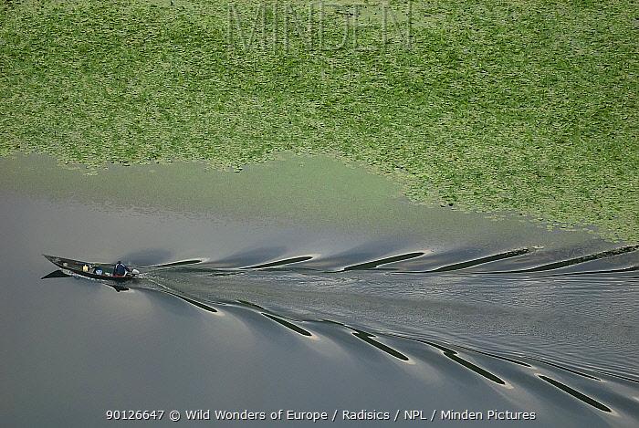 Fisherman's boat in channel between aquatic plants, River Crnojevica, near Pavlova Strana, Rijeka Crnojevica, Lake Skadar National Park, Montenegro, May 2008  -  WWE/ Radisics/ npl