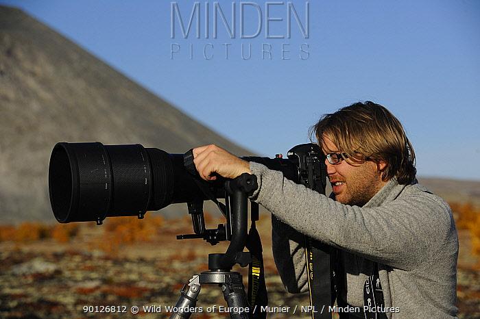 Laurent Joffrion looking through camera with long lens, Forollhogna National Park, Norway, September 2008  -  WWE/ Munier/ npl