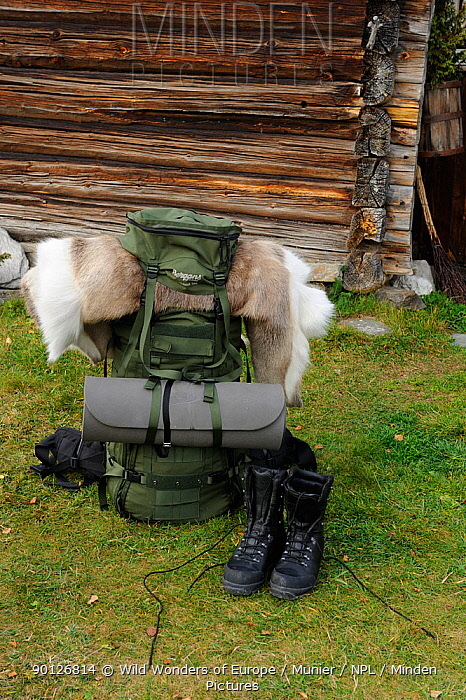 Rucksack and walking boots for camping expedition outside wooden building, Forollhogna National Park, Norway, September 2008  -  WWE/ Munier/ npl