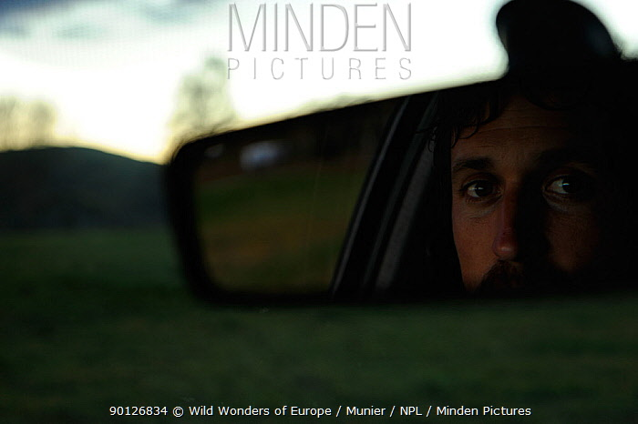 Photographer, Vincent Munier, reflected in rear view car mirror, Forollhogna National Park, Norway, September 2008  -  WWE/ Munier/ npl