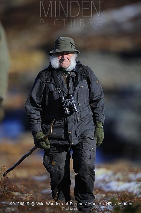 Man walking with binoculars, Forollhogna National Park, Norway, September 2008  -  WWE/ Munier/ npl