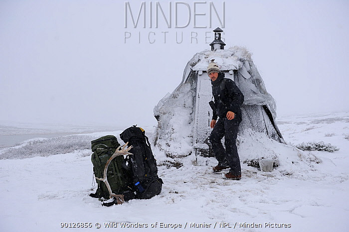 Photographer, Vincent Munier, outside hut, about to set off to photograph reindeer, Forollhogna National Park, Norway, September 2008 On location for Wild wonders of Europe  -  WWE/ Munier/ npl