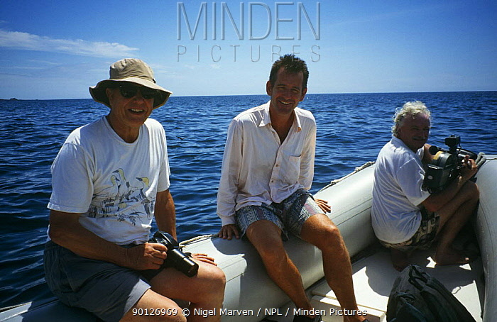 David Attenborough, Martin Saunders and Nigel Marven in boat, Galapagos Islands, for BBC Life of Birds  -  Nigel Marven/ npl