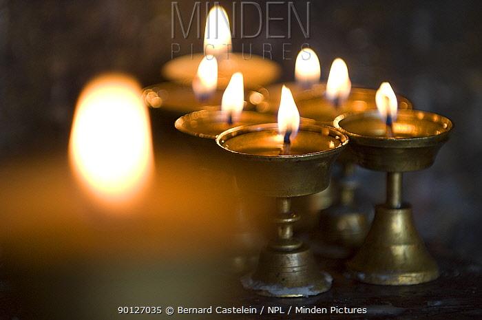 Lamps burning inside the butterlamp room in the Enchey Monastery, Gangtok, Sikkim, India  -  Bernard Castelein/ npl
