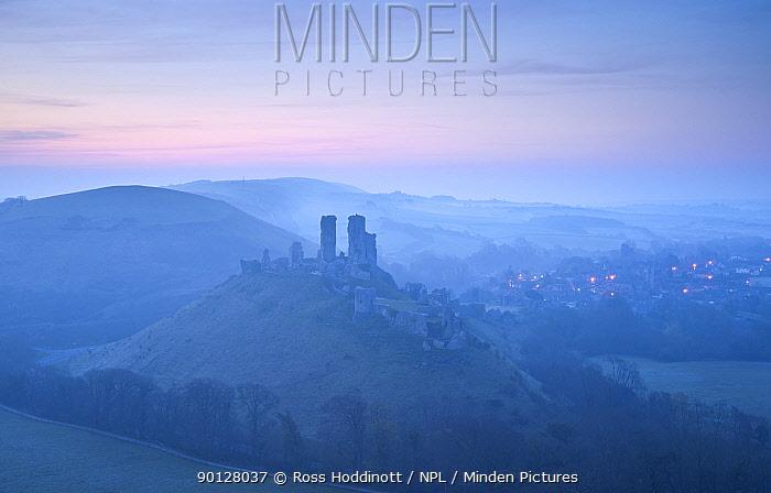 Corfe Castle, sunrise and early morning mist, view from West Hill, Corfe, Dorset, England, UK April 2010  -  Ross Hoddinott/ npl