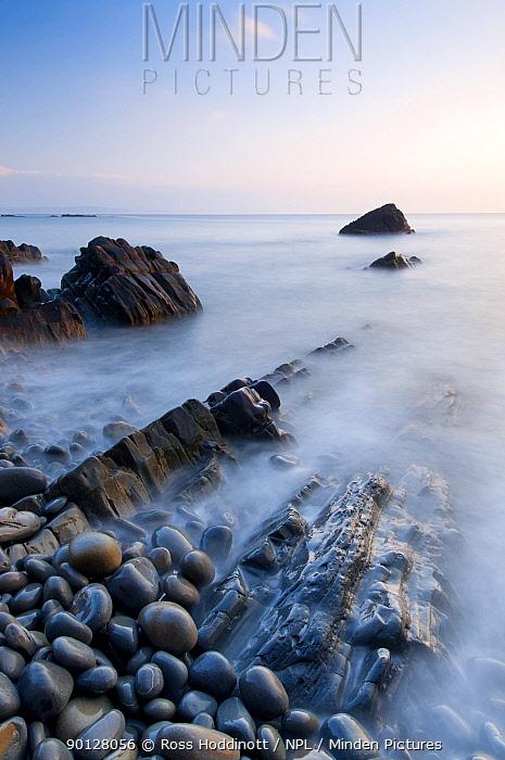 Sandymouth Bay, evening light and long exposure over rocks and pebbles, North Cornwall, England, UK April 2010  -  Ross Hoddinott/ npl
