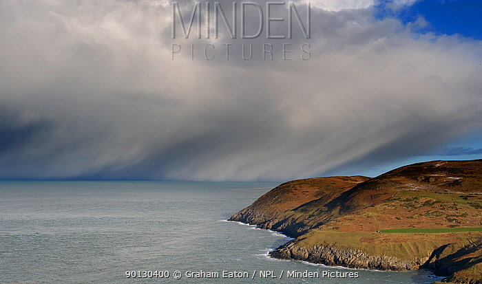 Snow-bearing clouds approaching the coast, viewed from the old coastguard station, Aberdaron, Gwynedd, Wales, January 2010  -  Graham Eaton/ npl