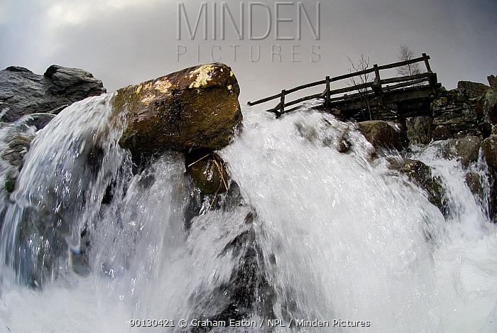 A view through a waterfall showing water turbulence around rocks, Snowdonia NP, Gwynedd, Wales, UK December 2009  -  Graham Eaton/ npl