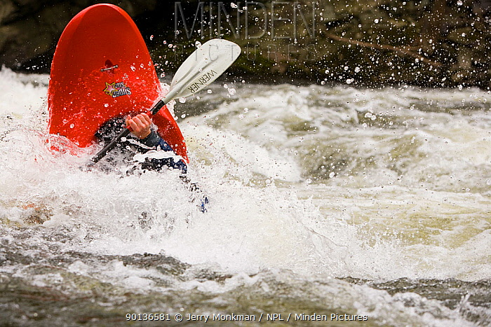 A kayaker plays in a hole in Tariffville Gorge on the Farmington River in Tariffville, Connecticut Class III whitewater May 2007 Model released  -  Jerry Monkman/ npl