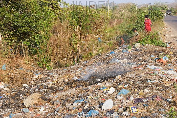 Children walking through roadside trash in Colombia, South America February 2008  -  Lisa Hoffner/ npl