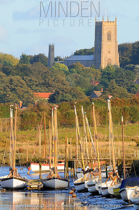 Boats in Morston harbour, with Blakeney Church in distance, North Norfolk, UK, October 2009  -  Gary K. Smith/ npl