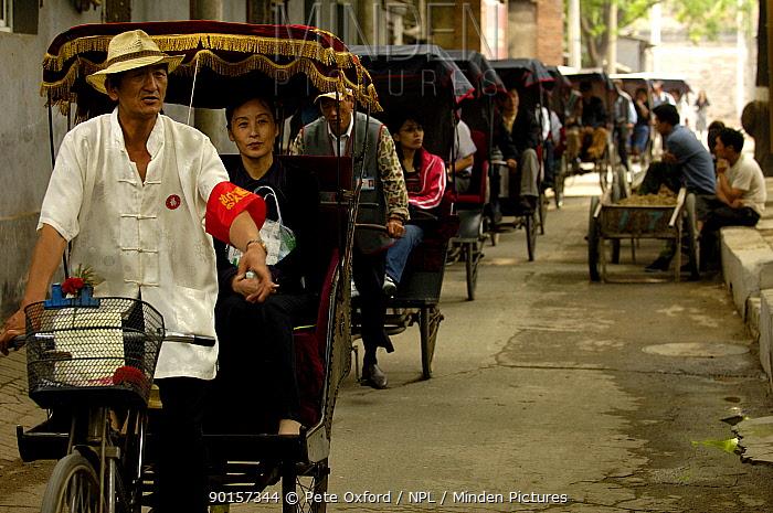 Chinese rickshaws driving through the narrow streets in Hutong (an old neighbourhood of Beijing) Beijing, China  -  Pete Oxford/ npl