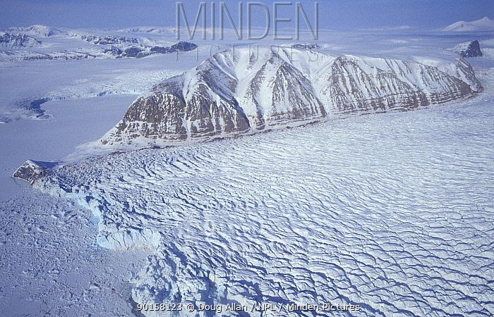 Heavily crevassed glacier (right) meets frozen sea ice (left) Svalbard, Norway  -  Doug Allan/ npl