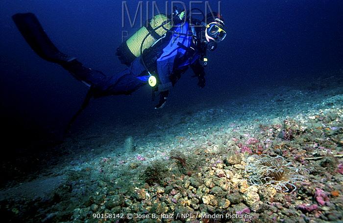 Diver swimming over seabed of broken shells and pebbles, Mediterranean  -  Jose B. Ruiz/ npl