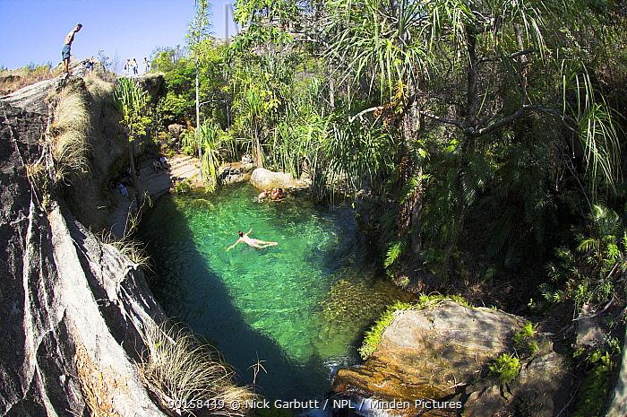 Swimming in natural swimming pool 'Piscene Naturelle' Isalo National Park, south Madagascar  -  Nick Garbutt/ npl