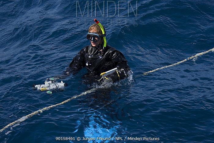Researcher Susan Sobtzik hanging on a 'minke line' with video recorder, on board the boat 'Undersea Explorer' Queensland, Australia, 2006  -  Jurgen Freund/ npl
