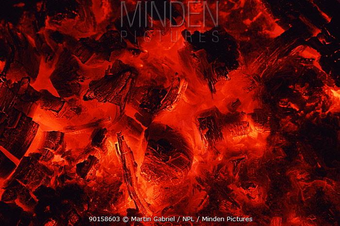 Fire embers glowing, Namibia  -  Martin Gabriel/ npl