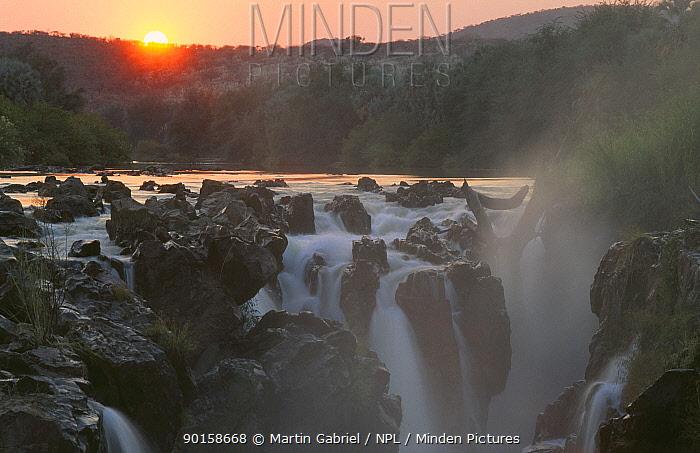 Sunrise at Epupa Falls, Kunene River, Kaokoveld, Namibia South-eastern Africa  -  Martin Gabriel/ npl