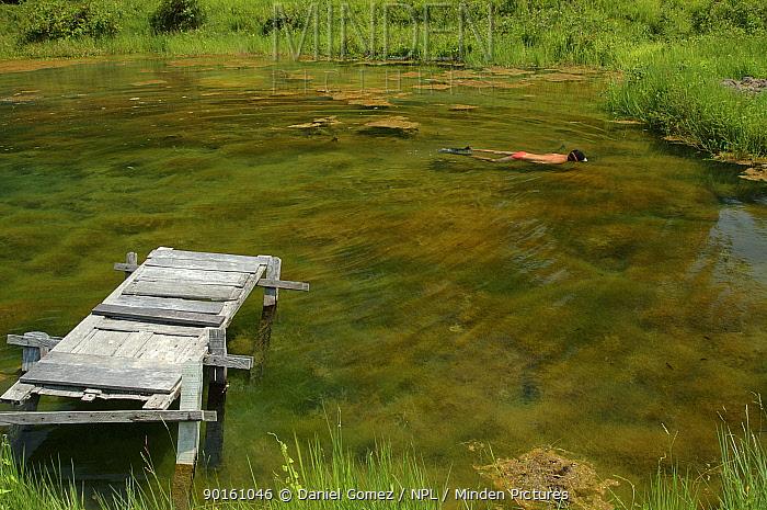 Man swimming in clear lake with jetty Para State, Brazil  -  Daniel Gomez/ npl