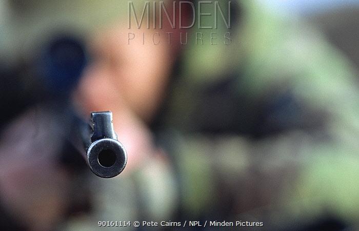 Looking down the barrel of a deer stalker's gun Knoydart, Scotland, UK  -  Pete Cairns/ npl