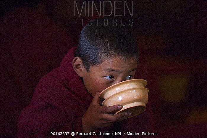 Young buddhist monk drinking, Galdan Namge Lhatse monastery, Golden Age Lhatse monastery, Tawang, Arunachal Pradesh, India 2005  -  Bernard Castelein/ npl