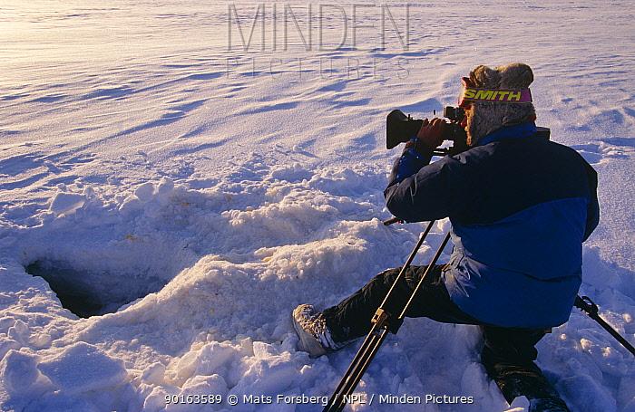 Cameraman Martin Saunders filming at ice hole for BBC 'Kingdom of the Ice Bear', April 1996, Leifdefj, Svalbard, Norway  -  Mats Forsberg/ npl