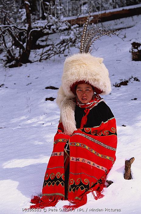 Nosi yi woman wears white fox hat (not traditional Red panda) Lijiang mtns, Yunnan, China 2002  -  Pete Oxford/ npl