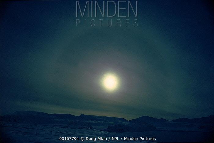 Parhelion sun effect over Coronation Island, South Orkneys, Antarctica  -  Doug Allan/ npl