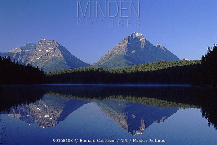 Mount Edith Cavell reflected in lake, Jasper NP, Canada  -  Bernard Castelein/ npl